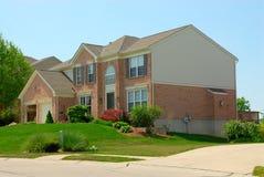 2-story Brick Suburban Home Stock Image