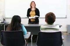 2 studenten en leraar Stock Foto
