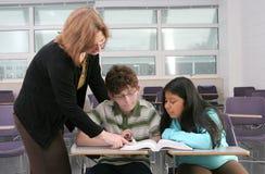2 studenten en leraar Stock Afbeeldingen