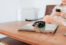 2 Sunglasses on Green Book Cover Stock Photography