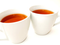 2 tazas blancas con té Imágenes de archivo libres de regalías