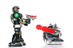 2 toy robots fighting Royalty Free Stock Photo