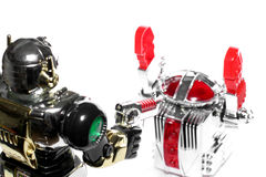 2 Toy Robots: Hands Up!! Royalty Free Stock Image