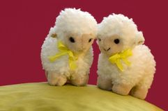 2 toy sheep in spring. A cute spring picture of two toy sheep on a green hill stock images