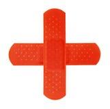 2 vendajes rojos que hacen CRO (coordinadora) rojas Fotos de archivo libres de regalías