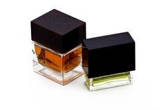 2 vierkante flessen parfum Stock Fotografie