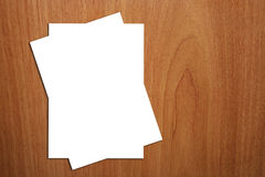 2 White A4 Page On Wood Background. There are two white empty A4 page on a wood background that can be a desk Royalty Free Stock Photo