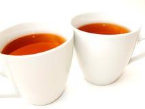 2 witte koppen met thee Royalty-vrije Stock Afbeeldingen