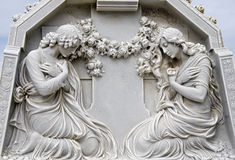 2 women praying. A statue of two women praying Stock Images