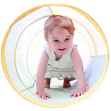 2 Year Old Girl Crawling in a Tunnel Stock Photos