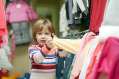 2 years baby in clothes shop Royalty Free Stock Image