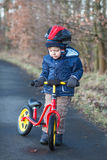 2 years old toddler riding on his first bike Stock Photo
