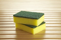 2 yellow scourer Royalty Free Stock Images