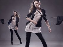 2 young brunettes posing. Fashion style photo of 2 young brunettes posing Stock Image