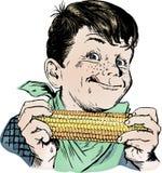 20世纪50年代吃葡萄酒的男孩玉米 免版税库存图片