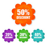 20, 30, 40, 50 percentages spring discount in four colors flower. 20, 30, 40, 50 percentages spring discount banners - text in four colors flowers labels Royalty Free Stock Image