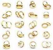 20 anéis de casamento isolados do ouro Fotografia de Stock Royalty Free