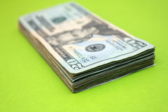 20 dollar bill. Stack of $20 bills over green background stock image