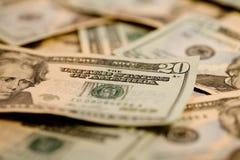 20 Dollar bills. A Stack of 20 Dollar Bills scattered randomly Royalty Free Stock Photos
