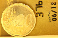 20 euro cent. Close up of a 20 euro cent with a golden credit card Stock Images