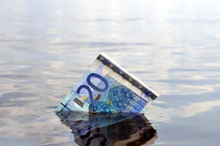 20 euro note sinking Royalty Free Stock Images