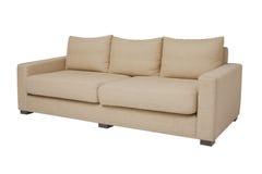 20 grados, sofá amarillento en blanco Fotografía de archivo libre de regalías