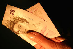20 pounds. Giving/taking of the England currency, 20 pounds royalty free stock photography