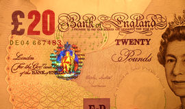 20 pounds, close-up. The very close-up of the England currency, 20 Pounds. The coloured hologram is clear lighted up Stock Photos