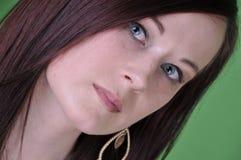 20 qualche cosa di ritratto femminile sullo schermo verde Immagine Stock