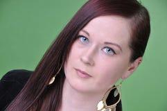 20 something female portrait on green screen Stock Photo