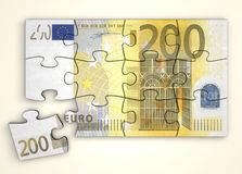 200 Euro Note Puzzle - Top View. 200 Euro note as a puzzle - one piece seperately - top view Stock Photo