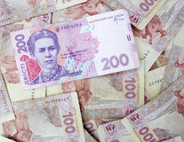 200 Ukrainian hryvnia. The national currency of Ukraine on the background of 100 Ukrainian hryvnias royalty free stock photo