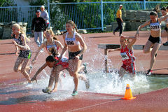2000 Meter Steeplechase. YALTA, UKRAINE - APRIL 27: unidentified girls compete in the 2000 Meter Steeplechase for girls age 16-17 on Ukrainian Junior Track and Stock Photo