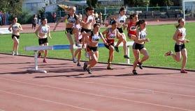 2000 Meter Steeplechase. YALTA, UKRAINE - APRIL 27: girls compete in the 2000 Meter Steeplechase for girls age 16-17 on Ukrainian Junior Track and Field Stock Photos