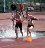 2000 Meter Steeplechase. YALTA, UKRAINE - APRIL 27: girls compete in the 2000 Meter Steeplechase for girls age 16-17 on Ukrainian Junior Track and Field Royalty Free Stock Photos