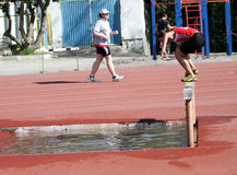 2000 Meter Steeplechase. YALTA, UKRAINE - APRIL 27: girl compete in the 2000 Meter Steeplechase for girls age 16-17 on Ukrainian Junior Track and Field Royalty Free Stock Photos