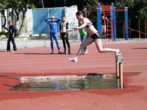 2000 Meter Steeplechase. YALTA, UKRAINE - APRIL 27: girl compete in the 2000 Meter Steeplechase for girls age 16-17 on Ukrainian Junior Track and Field Royalty Free Stock Images