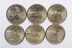 2001 US State Quarters a complete set of 5 used coins. Are located in the order of their released and joining the state Stock Photography