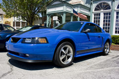 2003 Mustang Mach I. Blue 2003 Ford Mustang Mach I.  Front nose and side view, rally wheels Stock Images