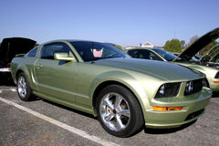 2005 Ford Mustang GT. Side view of a 2005 Ford Mustang GT Ivy green automobile with polished bullit wheels royalty free stock photo