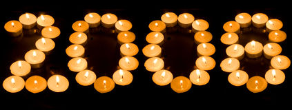 2008. Of candles isolated on black background Stock Photography