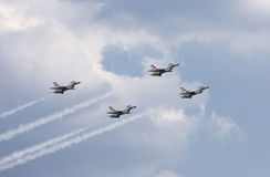 2008 Air Expo McGuire AFB. U.S. Air Force Thunderbirds Jet Demonstration Team performing difficult maneuver in the sky stock photos