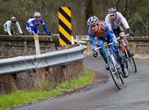 2008 AMGEN Tour of California Bike Race. Riders make sharp right turn at the narrow bridge on Oakville Grade in Napa County during the 2nd stage of the 2008 Stock Image