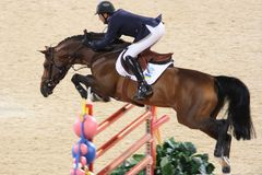 2008 Olympic Equestrian G. Van Geenberghe Jean-Claude from Ukraine made an excellent jump with Quintus in Team Jumping Final - Round 01 & Individual Jumping 2nd Stock Image