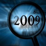 2009. On a blue background with a magnifier stock illustration