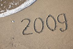 2009 beach. Number 2009 written in the sand of the beach stock images