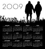 2009 Calendar. Featuring a silhouette of a couple holding hands.  Vector format available.  Room for text Stock Photography