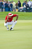 2009 Commercial Bank Qatar Masters tournament. Quiros studying the green on the 18th and final hole of the 2009 Qatar Commercial Bank Masters Tournament Stock Photography