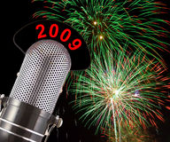 2009 Fireworks. 2009 message on vintage microphone with fireworks in the background.  This image conveys the concept of celebrating the 2009 New Year Royalty Free Stock Photography