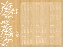 2009 Wood calendar. 2009 calendar with wood background and white foliage. Week starts on Sunday Stock Photography